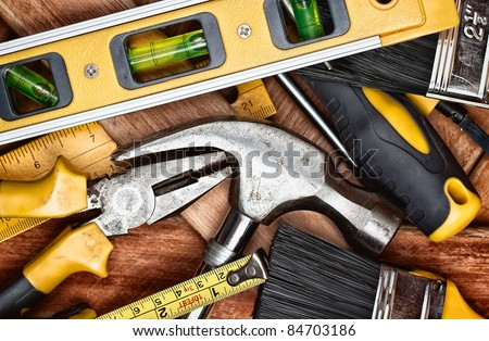Set of manual  tools on a wooden boards background - stock photo