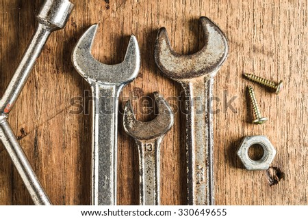 Set of manual tools on grunge wood background