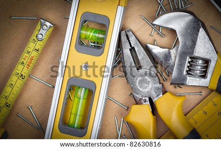 Set of manual tools over a wooden panel