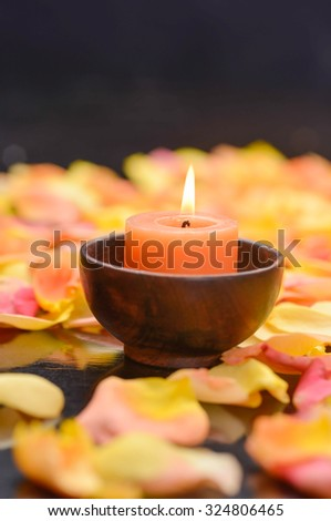 Set of many rose petals with candle in bowl - stock photo