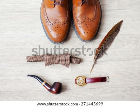 Set of men's clothing and accessories on light gray wooden background