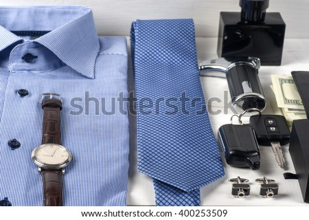 set of men's clothing  on wooden background. Men's casual clothes and accessories on wooden background. - stock photo