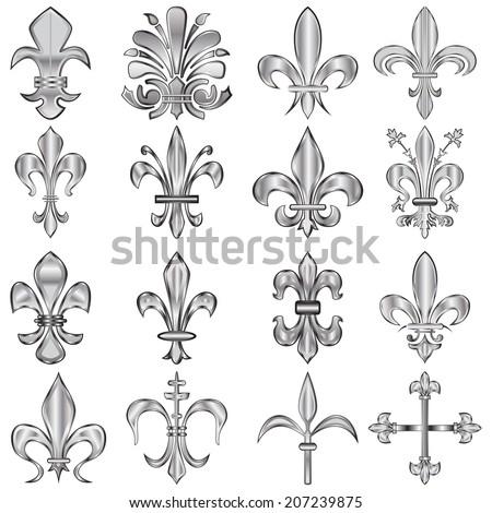 Set of metal Fleur-de-lis on white - stock photo