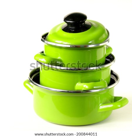 set of metal green pots on a white background - stock photo