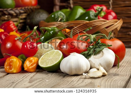 Set of mexican vegetables arranged on top of a wooden table - stock photo