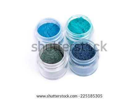 Set of mineral eye shadows in blue color, isolated on white background  - stock photo