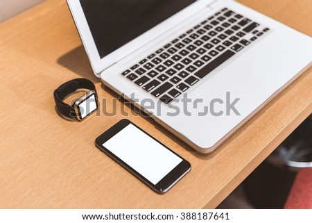 set of modern computer devices  - laptop, watch and phone close up