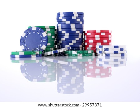 Set of multi-colored gambling chips on white with reflection - stock photo