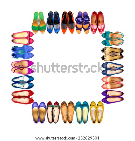 Set of multicolored female shoes arranged in frame on white background. - stock photo