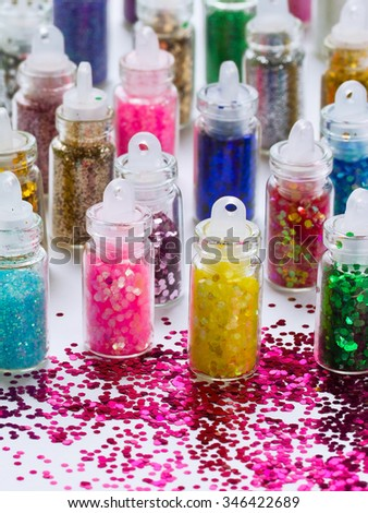 Set of multicolored glitter on a white background, selective focus, close-up - stock photo
