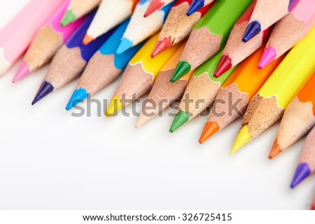 Set of multicoloured pencils lying on white table in pile no order Creativity, art skill and school, variety of possibilities, game of imagination and fantasy, make world vivid and impressive concept - stock photo