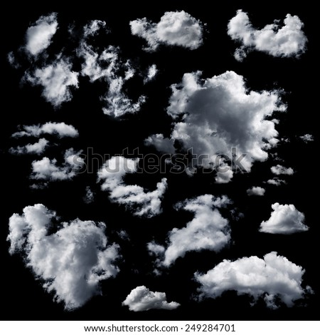 Set of multiple clouds and cloud formations isolated against the black background - stock photo