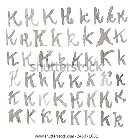 Set of multiple hand drawn with black watercolor ink K letters isolated over the white background - stock photo