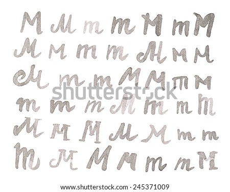 Set of multiple hand drawn with black watercolor ink M letters isolated over the white background - stock photo