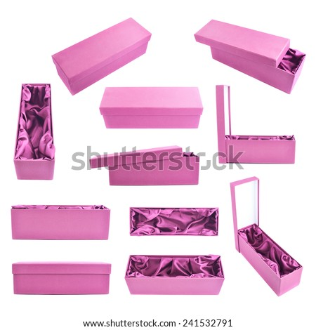 Set of multiple pink tall gift boxes with the velvet cloth inside, isolated over the white background - stock photo