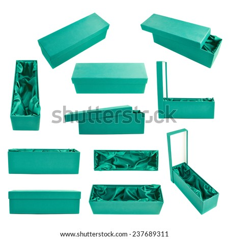 Set of multiple sea green tall gift boxes with the velvet cloth inside, isolated over the white background - stock photo