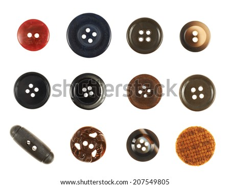 Set of multiple sew-through cloth buttons isolated over the white background - stock photo
