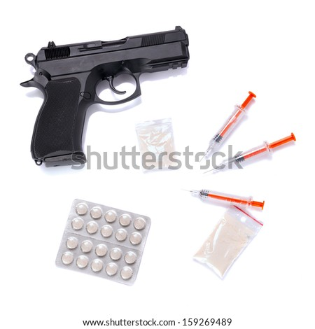 Set of narcotics and handgun isolated over white - stock photo