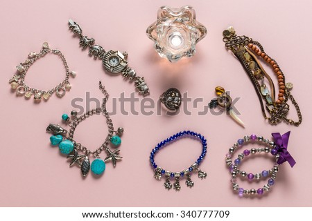 Set of natural material necklaces on pink background - stock photo