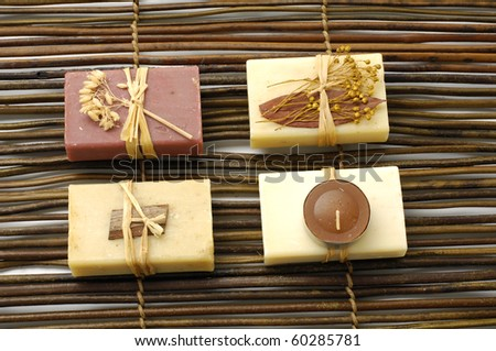 Set of nature soap on bamboo mat - stock photo