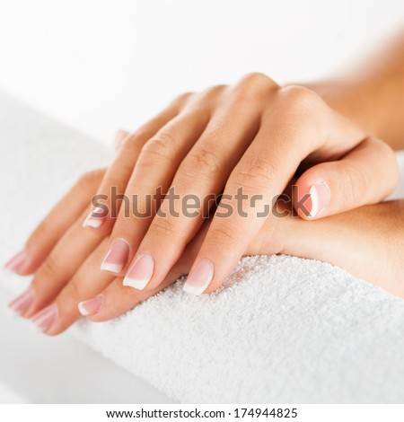 Set of nicely manicured fingernails with french manicure over white background.  - stock photo