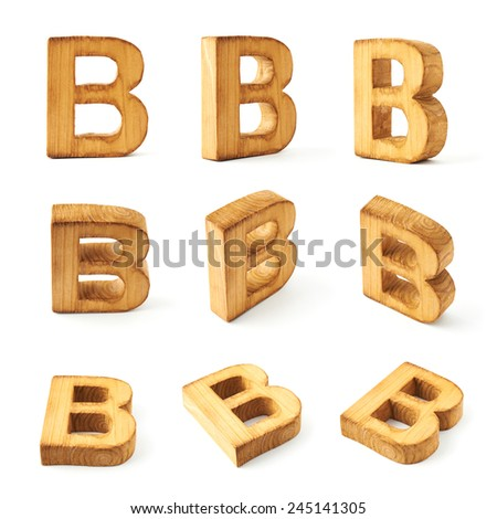 Set of nine block wooden capital B letters in different foreshortenings isolated over the white background - stock photo