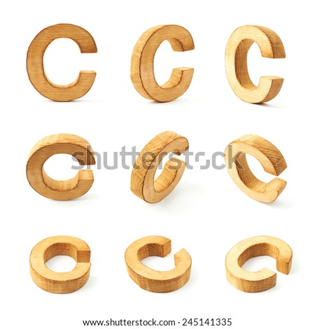 Set of nine block wooden capital C letters in different foreshortenings isolated over the white background - stock photo