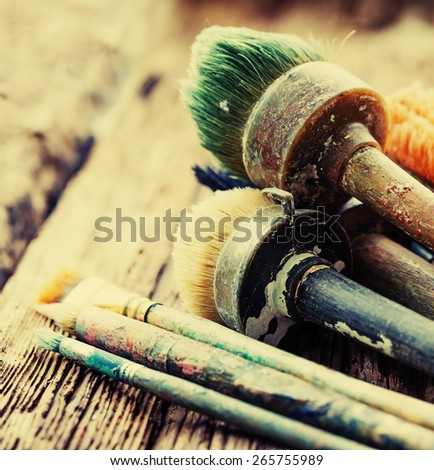 Set of old brush for coloring the walls/ Brush painting wooden furniture, close up/Paintbrush on wood background - stock photo