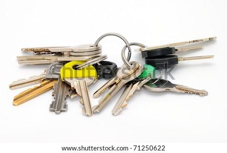 Set of old house keys isolated on the white background. - stock photo