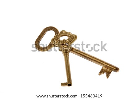 Set of old key with golden tones isolated on white - stock photo