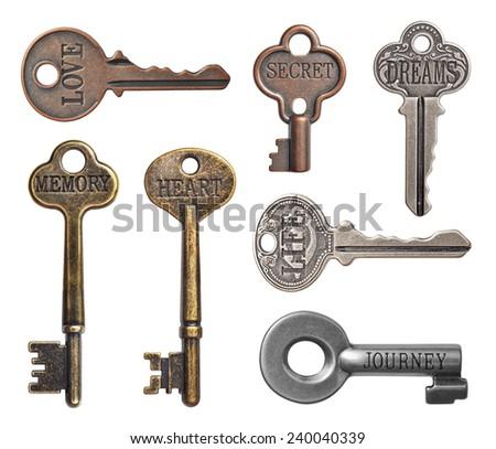 Set of old keys isolated on white background - stock photo