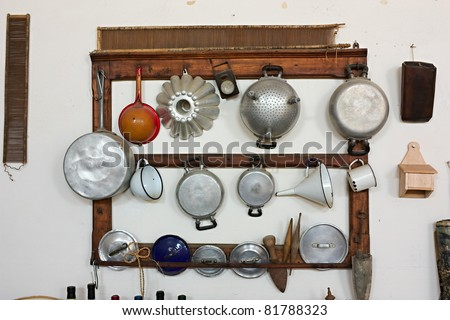 set of old kitchen tools - retro equipment of grandmother cooking - pans and utensils of old times - stock photo