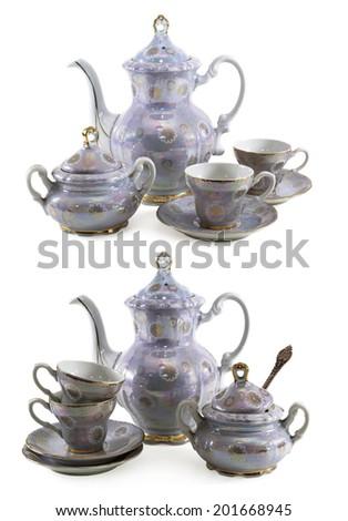 Set of old porcelain service isolated on white - stock photo