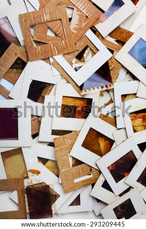 Set of old slides, photos and film on the table - stock photo