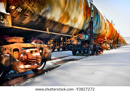Set of old tanks with oil and fuel transport by rail in winter - stock photo