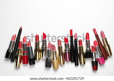 Set of opened various colorful cosmetic lipsticks on white background with copy space. Top view point.