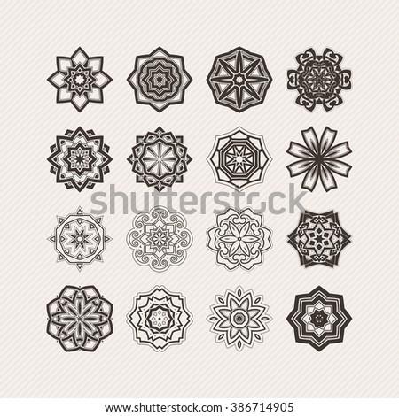 Set of ornate mandala symbols. Gothic lace tattoo. Celtic weave with sharp corners. The circular pattern. - stock photo