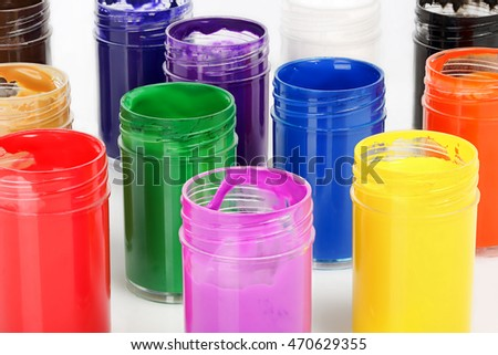 set of paints in containers closeup