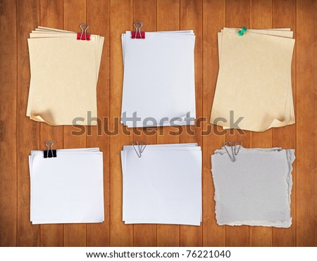 set of paper with clip over wood pane - stock photo