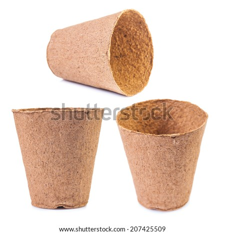 set of peat pots in defferent foreshortenings isolated - stock photo