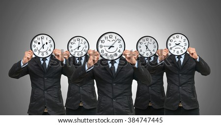 set of 5 picture of Asian businessman holding the clock to close his face with smile motion each time on white background - stock photo