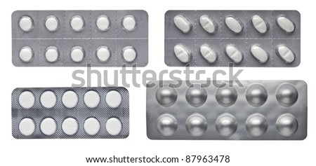 Set of pills in a plastic blister package - stock photo