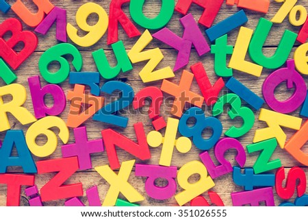Set of plastic colorful numbers and alphabet letters   - stock photo