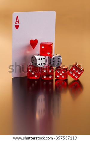 set of playing card with dices on reflective table