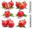 Set of pomegranate fruits with green leaf and cuts isolated on white background - stock photo