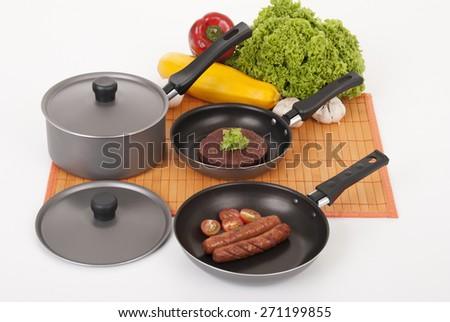 set of pots for cooking food on white background - stock photo