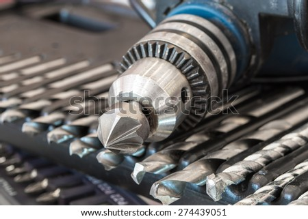 Set of Power drill and screwdriver on Tool box - stock photo