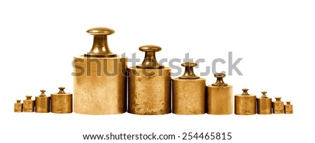 set of precision weights for a balance scale - stock photo