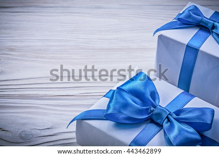 Set of present boxes on wooden board celebrations concept. - stock photo