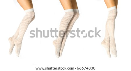 Set of pretty woman legs wearing fishnet stockings isolated on white.